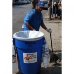 Man with the John Fund Project cleaning the street