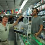 Man purchasing a floor fan inside electronics store