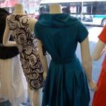 View of street behind dresses on display