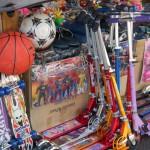 Toys for sale outside, skooters, basketball, soccer ball